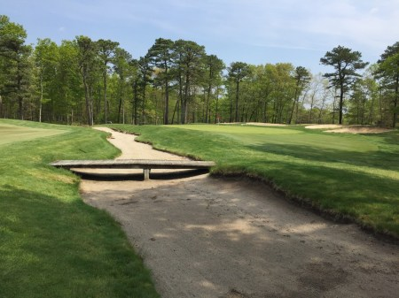 Sand trap along front of 7th green grabs any short approach shots.